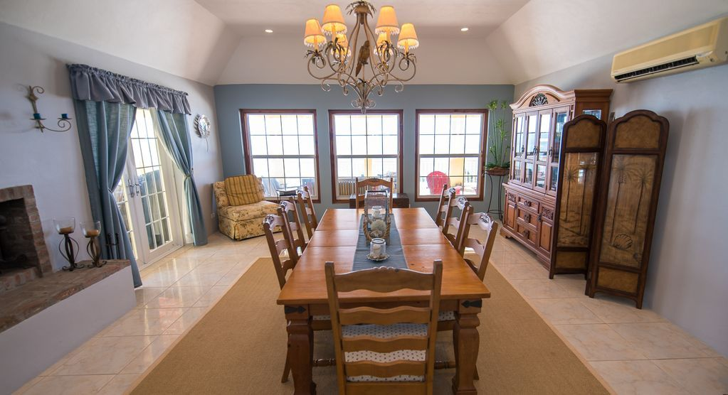 Plenty of indoor dining room or opt for outdoor table through French doors.
