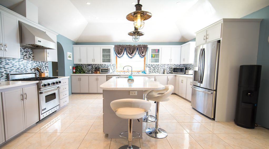 Large executive kitchen with stainless steel appliances. No one is under foot!