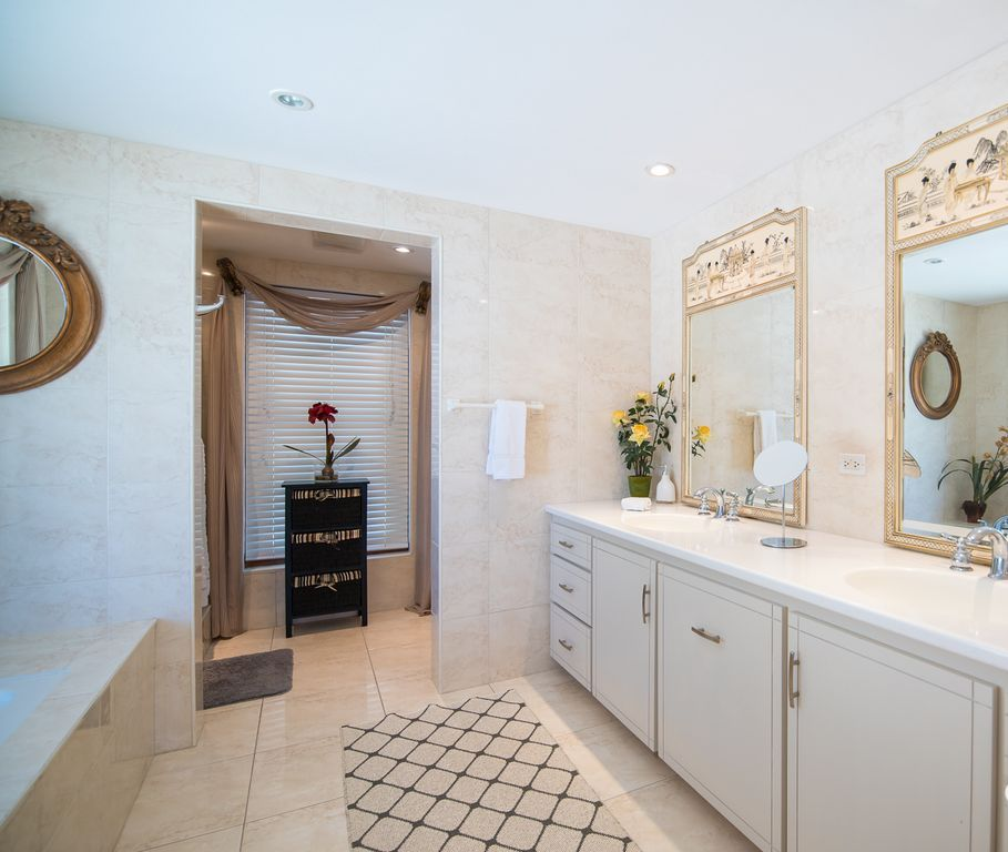 Double vanity with mother-of -pearl mirrors creates your own private sanctuary.