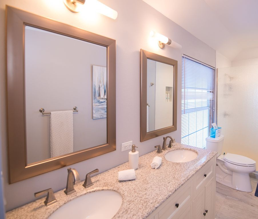 Double vanity, a large walk-in shower with rain glass is spacious and funct.