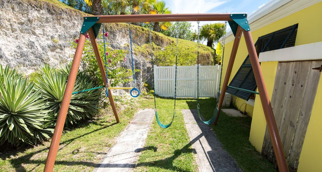 Swing set and basketball net will provide endless outdoor entertainment.